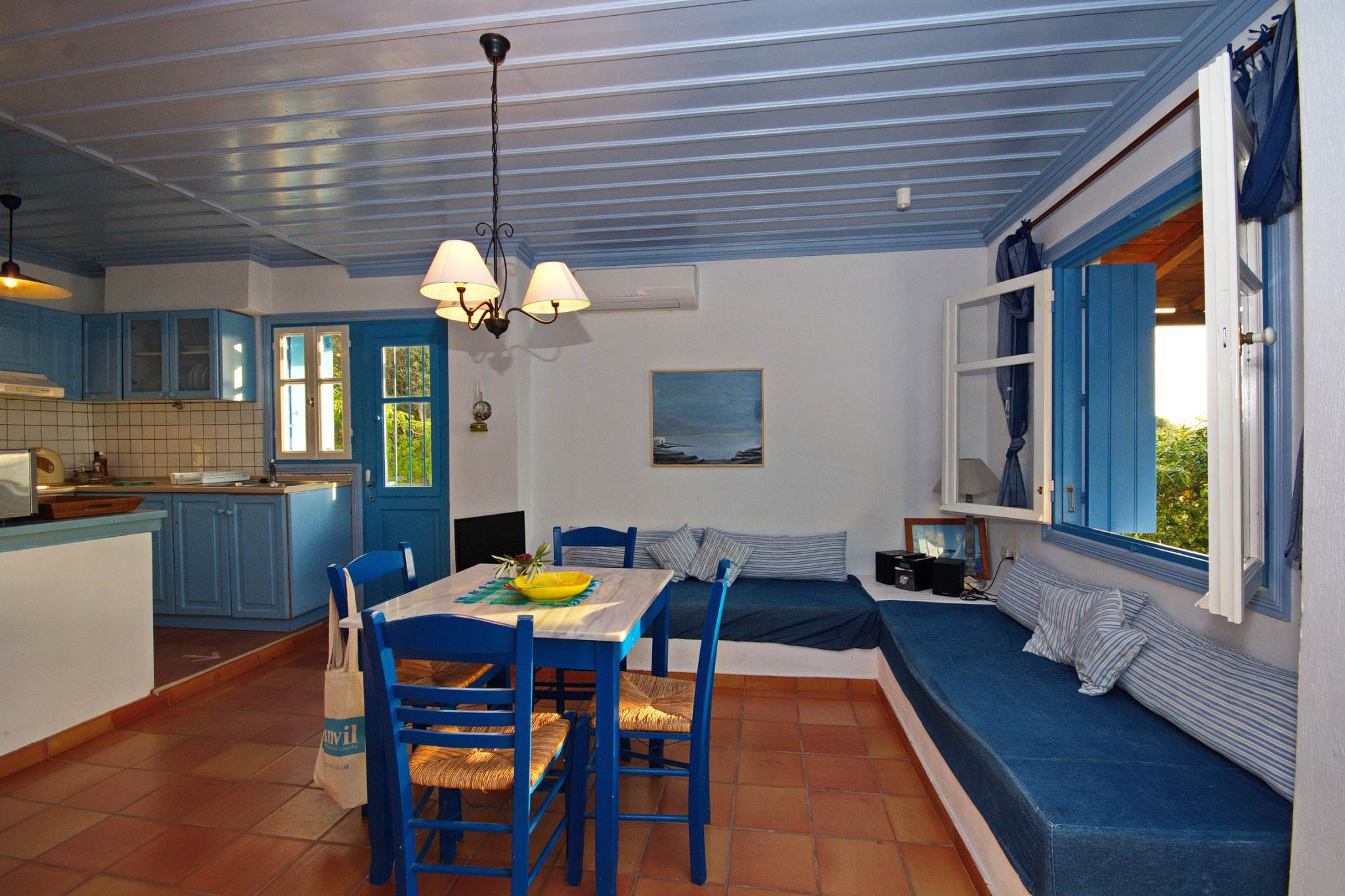 A charming traditional Greek family cottage looking over the quaint harbor of Steni Vala. Provid...